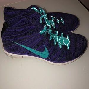 Nike flyknit chukka high top sneakers.